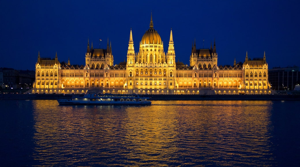 Parliament Building showing an administrative building, a ferry and night scenes