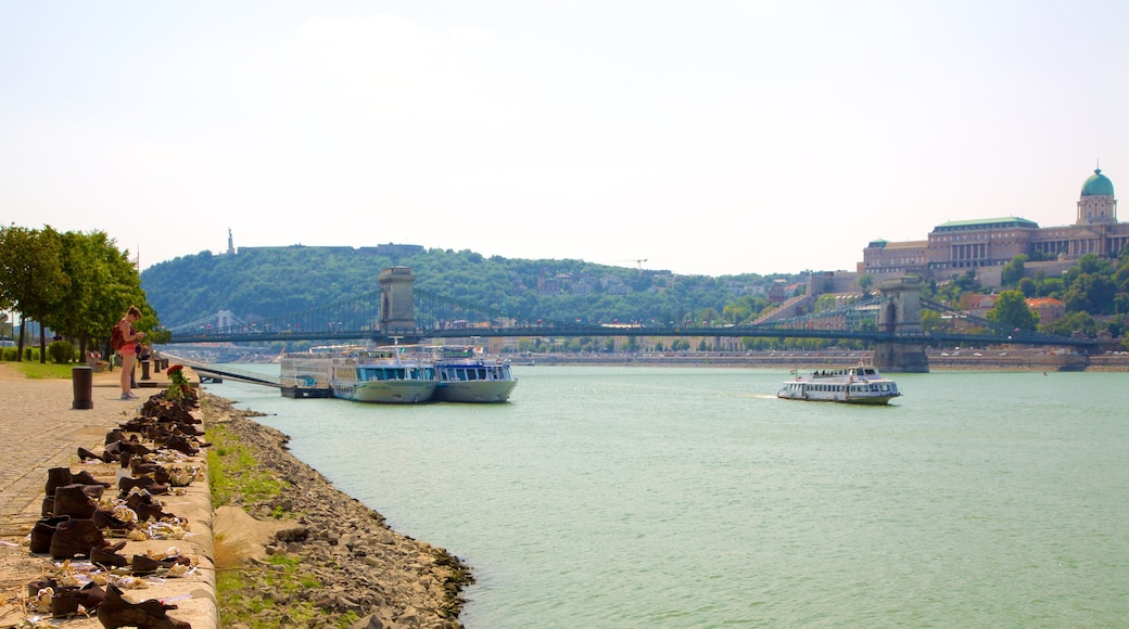Budapest showing a river or creek, a ferry and a bridge