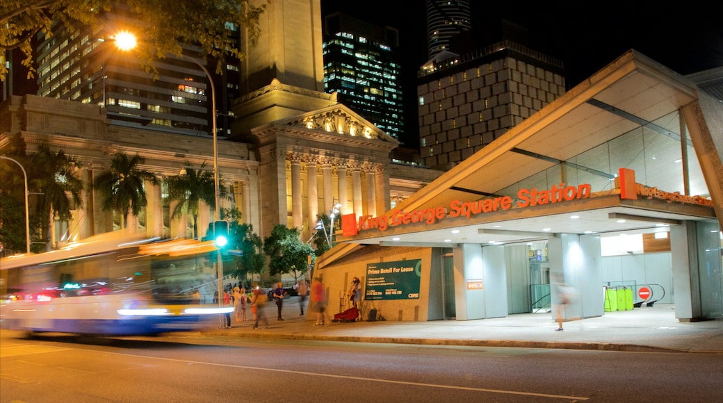 King George Square which includes a city, night scenes and street scenes
