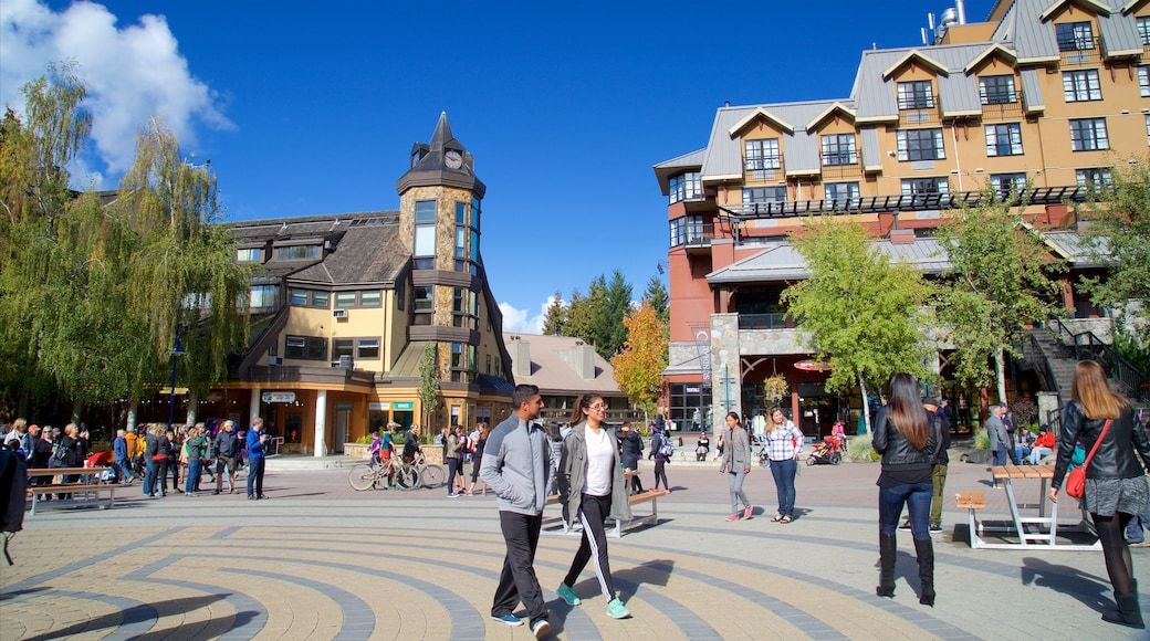 Whistler Blackcomb Ski Resort showing a luxury hotel or resort and a square or plaza as well as a large group of people