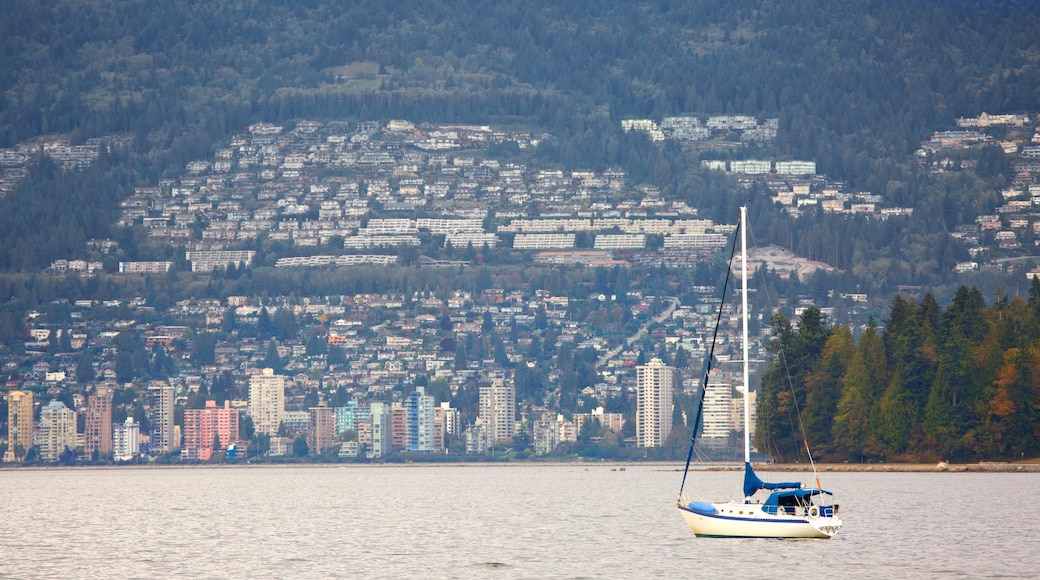 Kitsilano Beach which includes sailing, a city and a bay or harbour