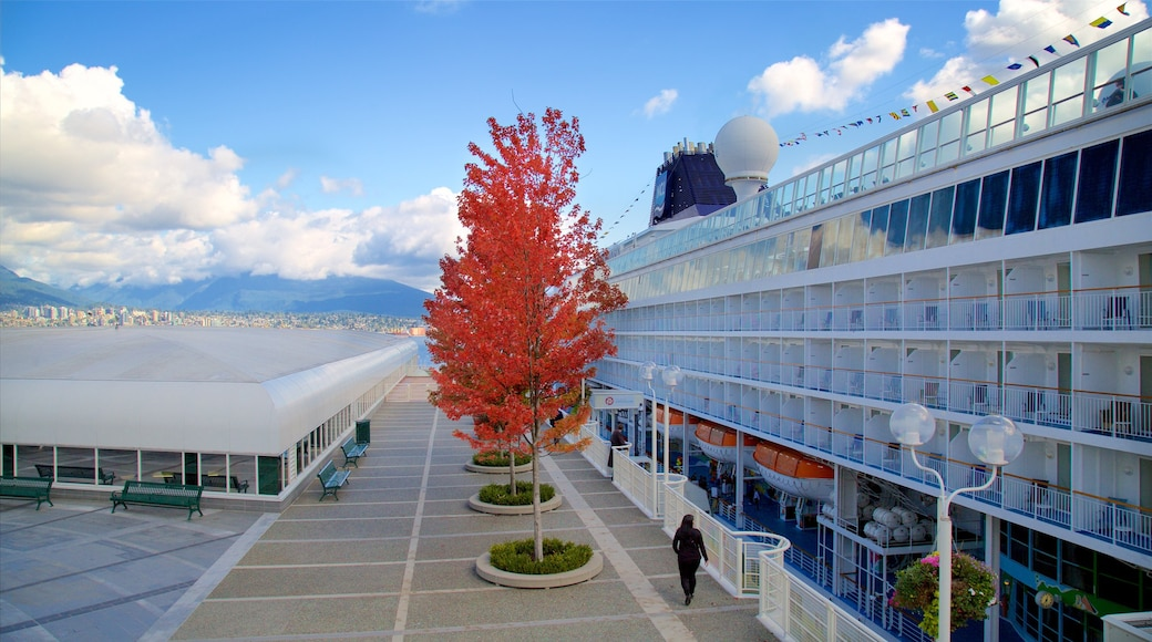 Canada Place featuring cruising, autumn leaves and a marina