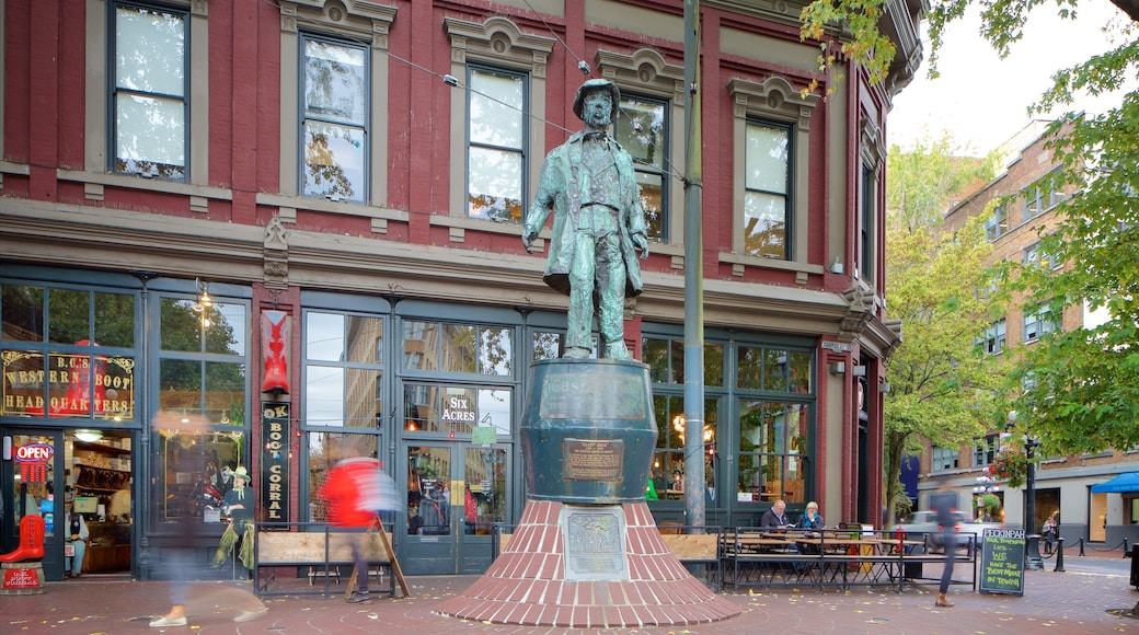 Gastown which includes street scenes, heritage architecture and a statue or sculpture