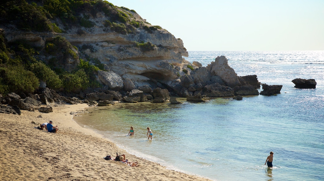 Prevelly Beach featuring rugged coastline, a bay or harbour and a sandy beach