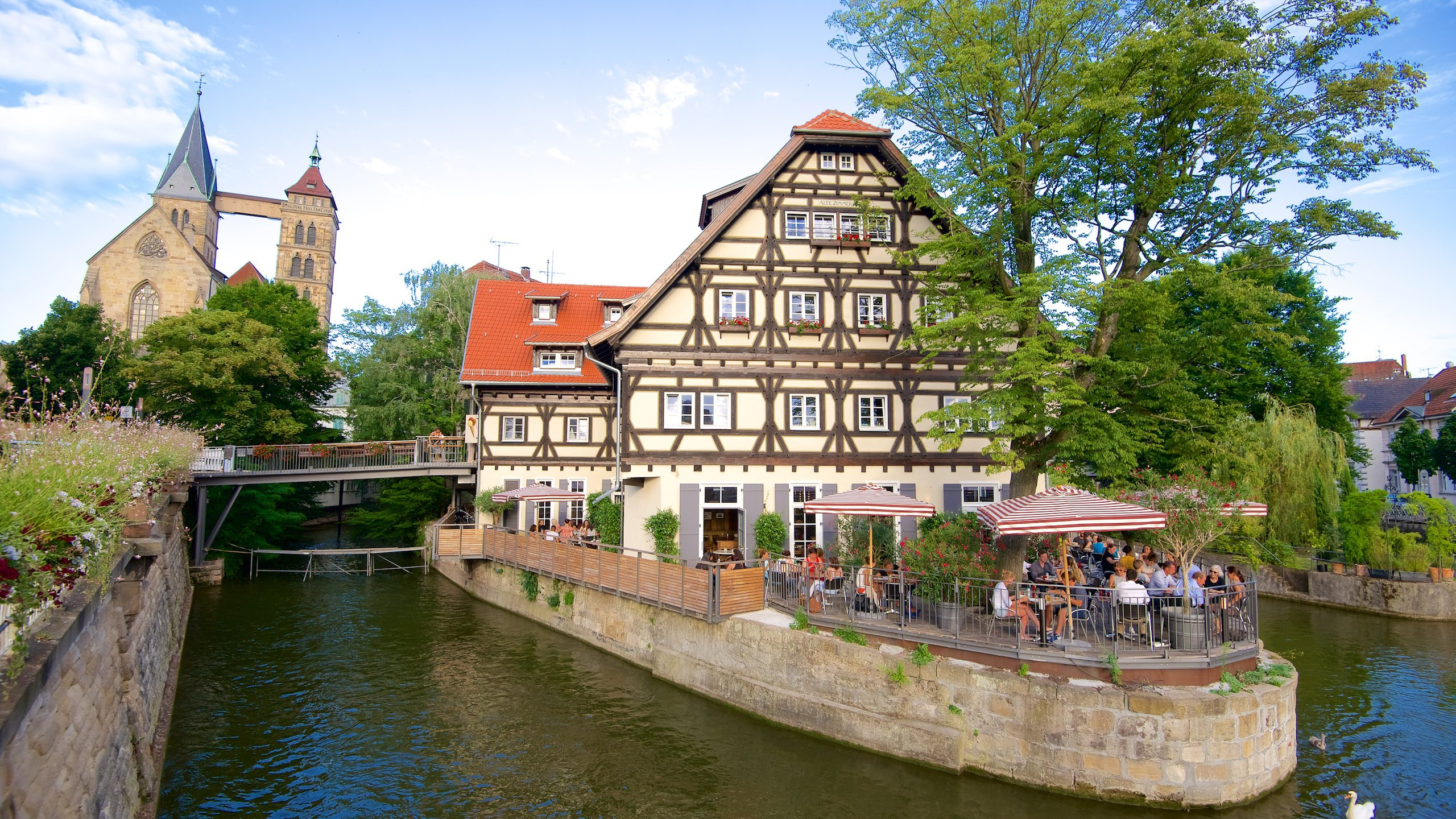Esslingen which includes a river or creek and outdoor eating