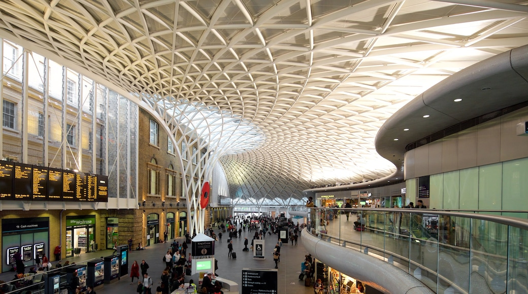 Kings Cross St. Pancras which includes modern architecture and interior views as well as a large group of people