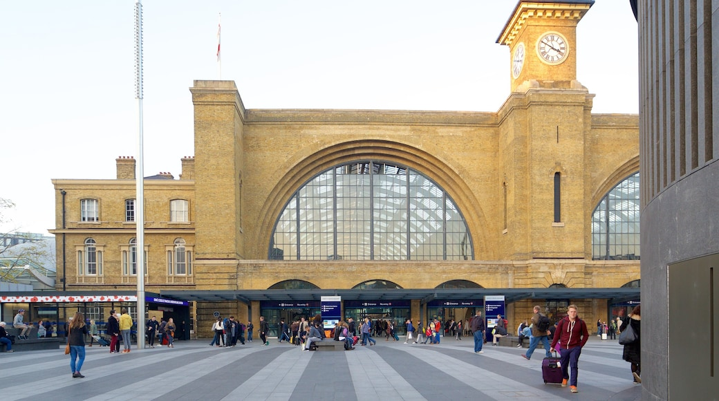 Kings Cross St. Pancras featuring heritage architecture as well as a large group of people