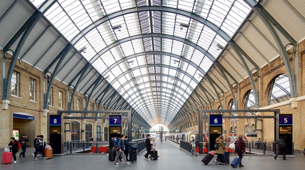 Kings Cross St. Pancras which includes heritage architecture and interior views as well as a small group of people