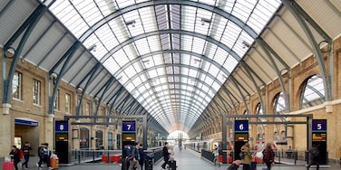 Kings Cross St. Pancras which includes interior views and heritage architecture as well as a small group of people