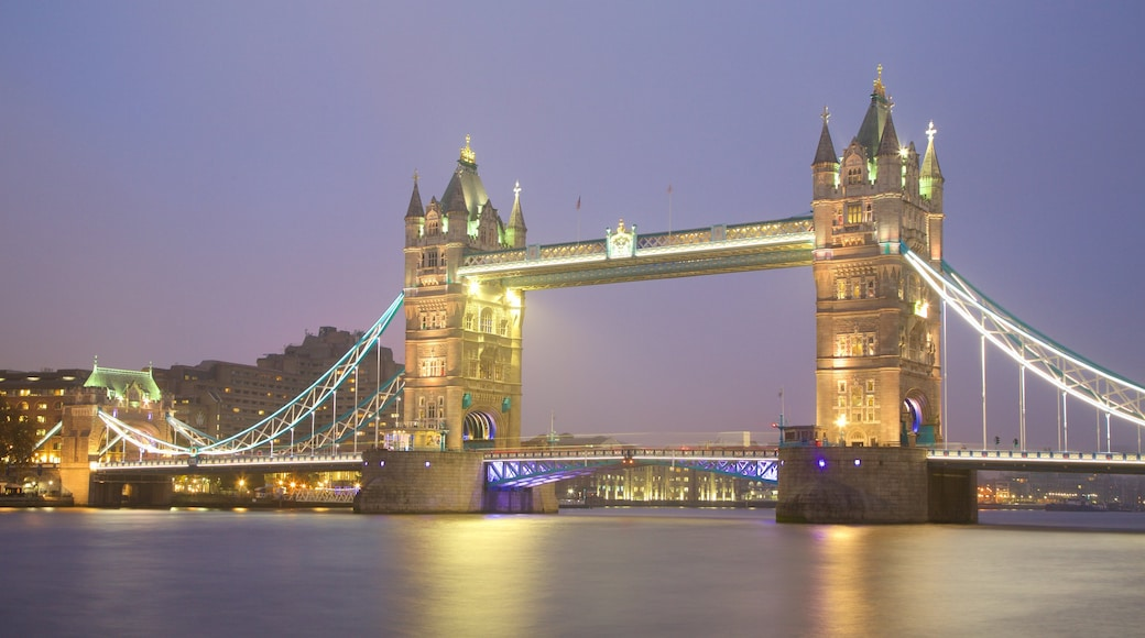 Tower Bridge showing a river or creek, a bridge and night scenes