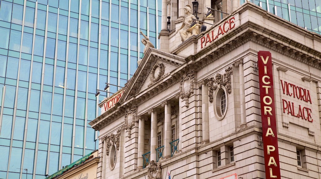 Victoria Palace Theatre featuring heritage architecture, signage and theater scenes