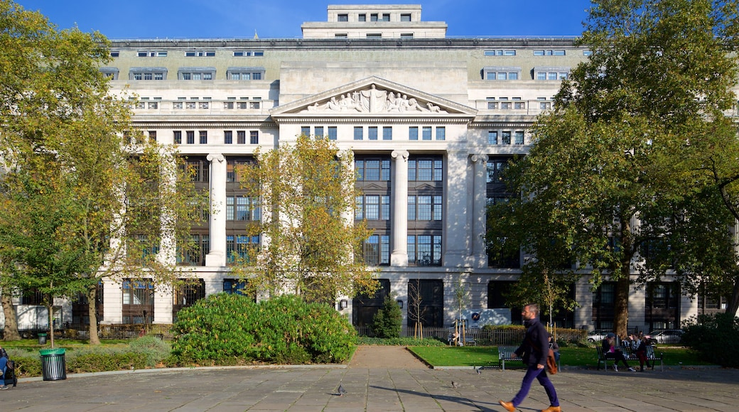 Bloomsbury Square which includes heritage architecture and a square or plaza as well as an individual male