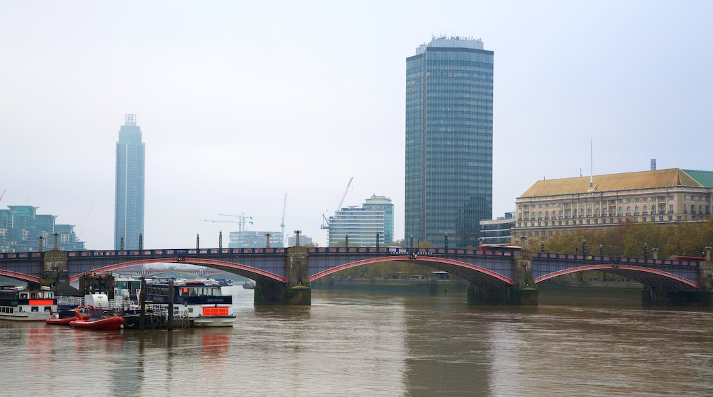 Lambeth Bridge featuring a river or creek, a marina and a bridge