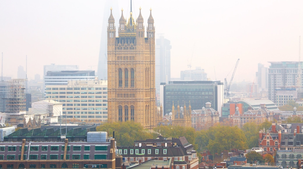 Houses of Parliament which includes heritage architecture, a city and mist or fog