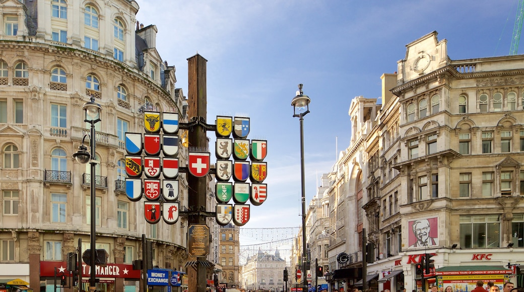 Leicester Square showing signage, heritage architecture and a city