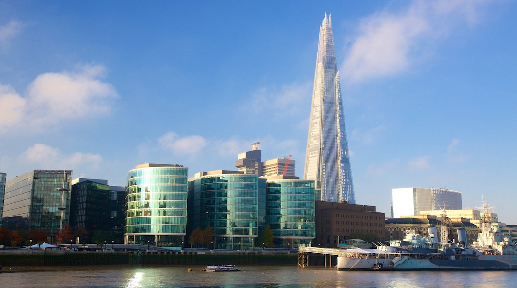 The Shard featuring a high-rise building, modern architecture and a city