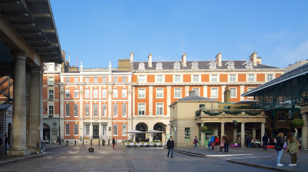 London showing markets, a square or plaza and heritage architecture