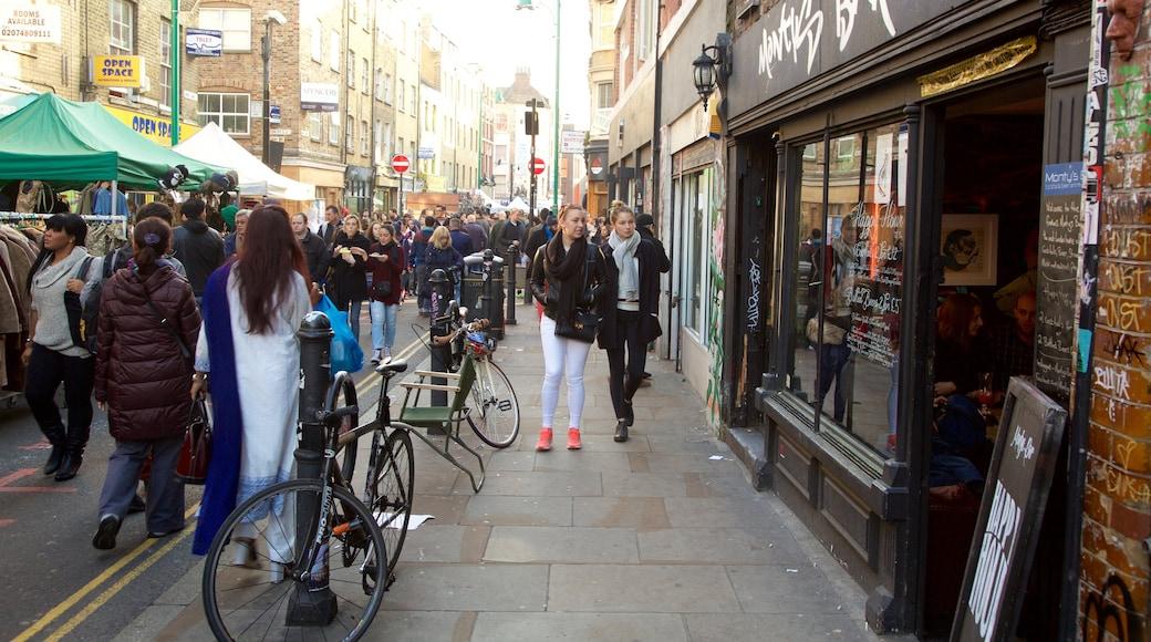London som inkluderar gatuliv, marknader och en stad
