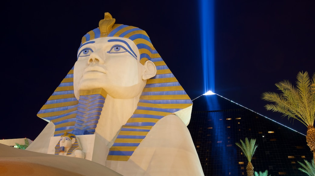 Las Vegas featuring a casino, a statue or sculpture and night scenes