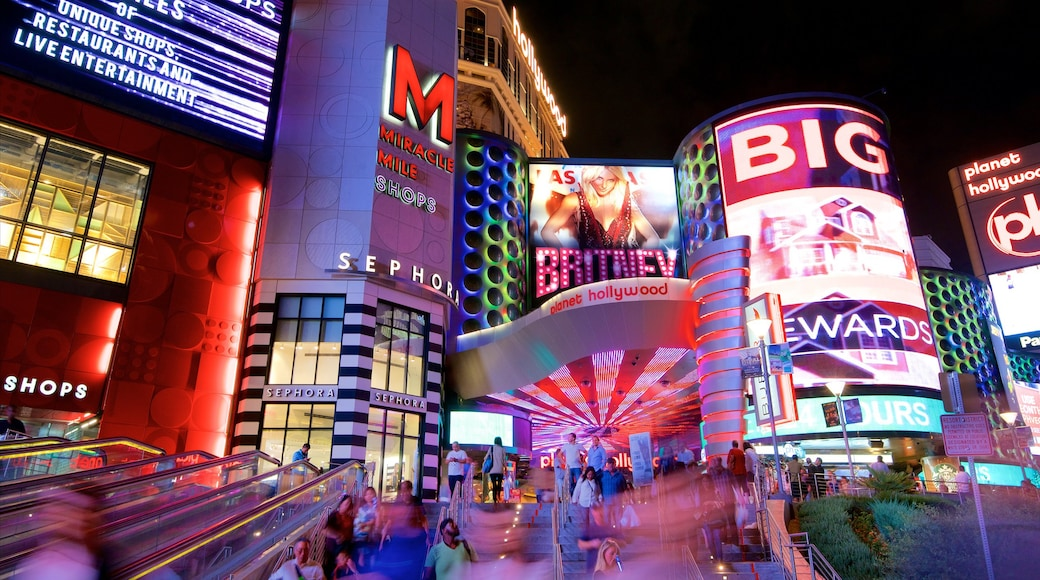 Miracle Mile Shops which includes signage, night scenes and a casino