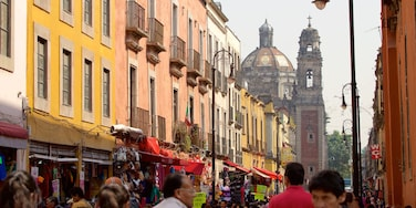 Downtown Mexico City which includes a city and central business district as well as a large group of people