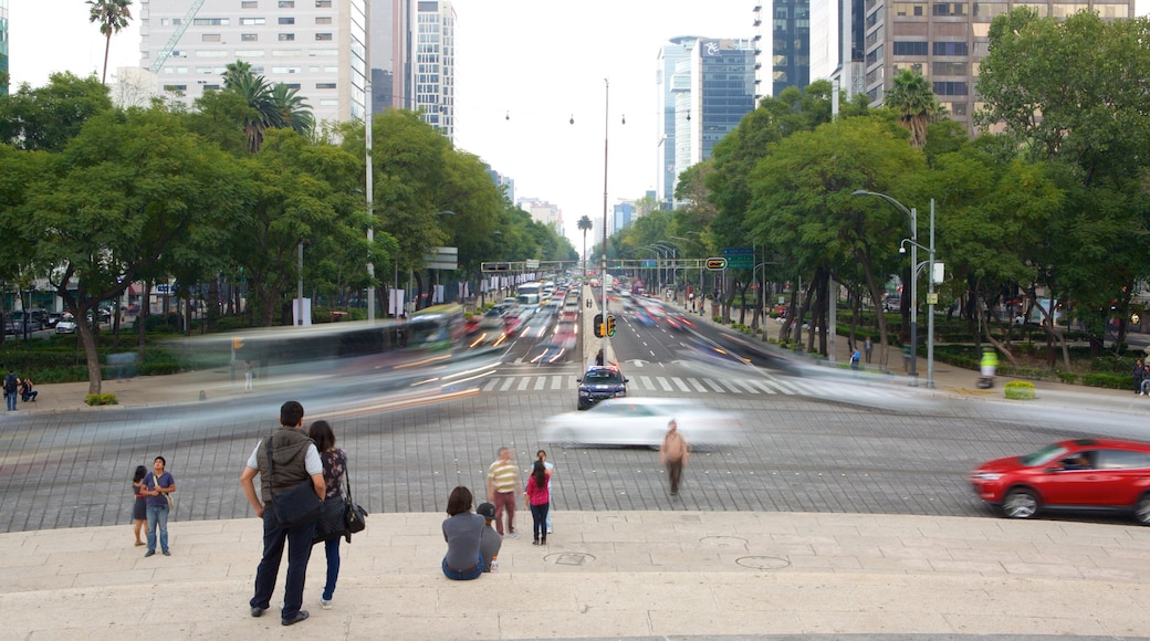 Reforma featuring a city as well as a small group of people
