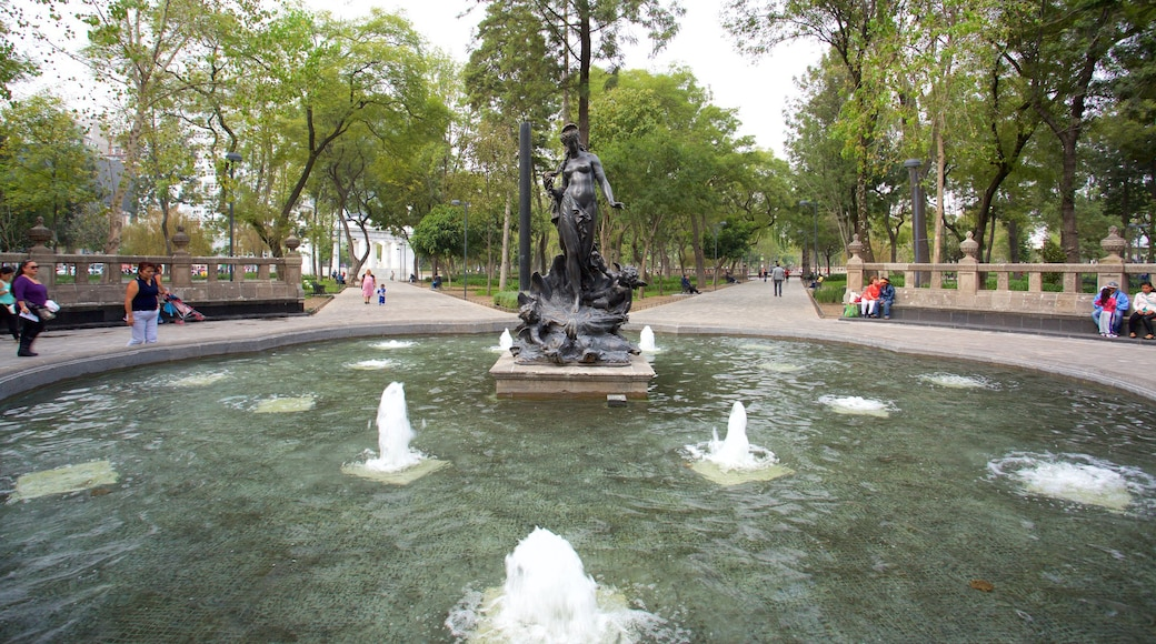Alameda Central featuring a fountain, a park and a statue or sculpture