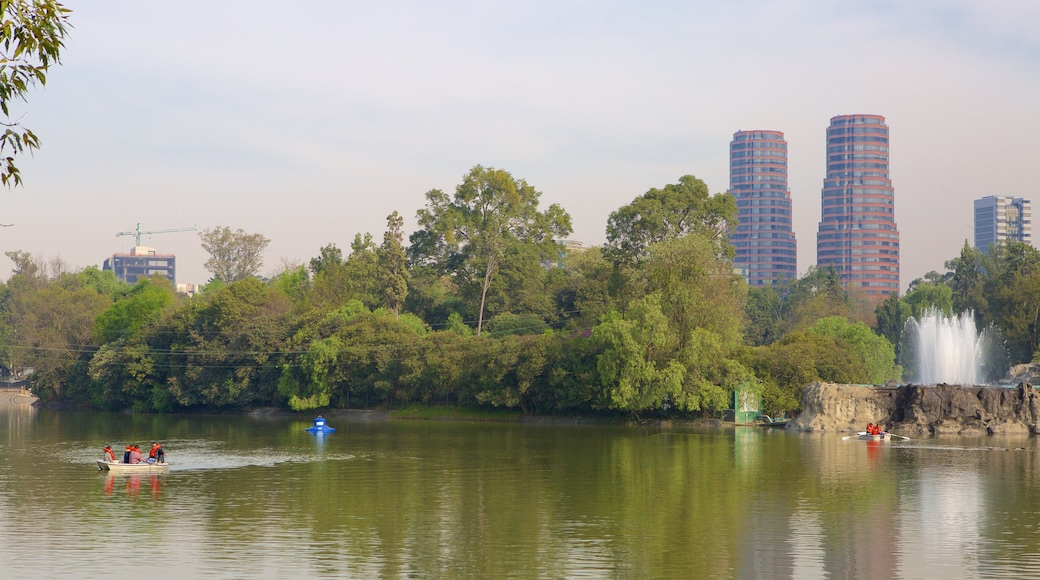 Chapultepec Park showing a city, a garden and a lake or waterhole