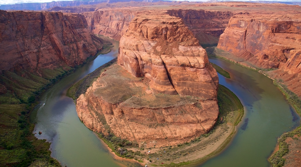 Horseshoe Bend which includes desert views, a gorge or canyon and a river or creek