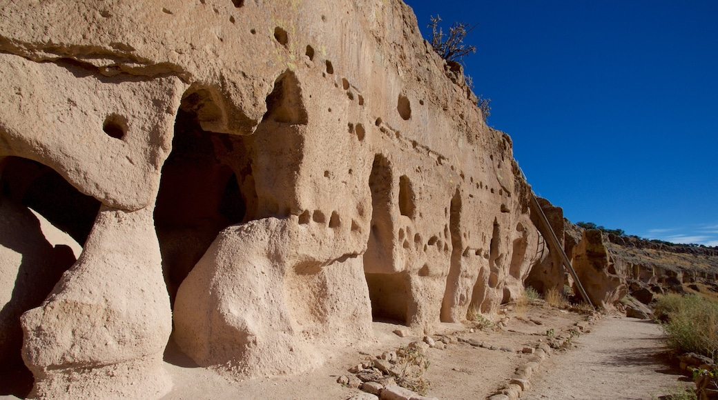 Puye Cliff Dwellings which includes heritage elements and building ruins