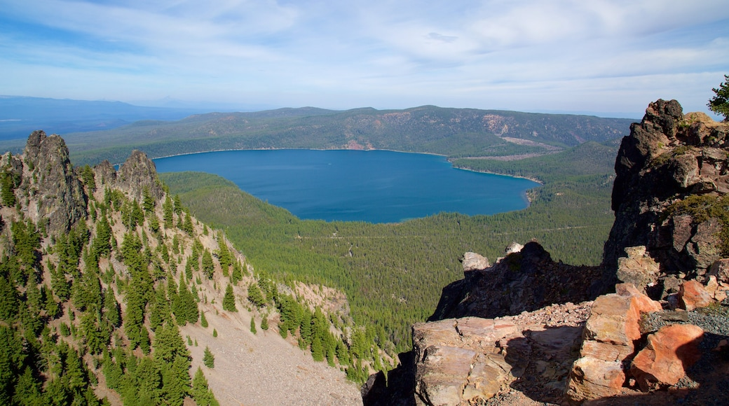 Newberry National Volcanic Monument showing forests, a lake or waterhole and landscape views