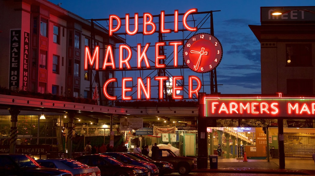 Pike Place Market featuring signage, a city and night scenes