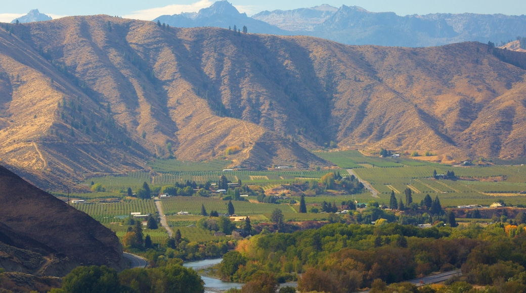Wenatchee which includes tranquil scenes, mountains and a river or creek