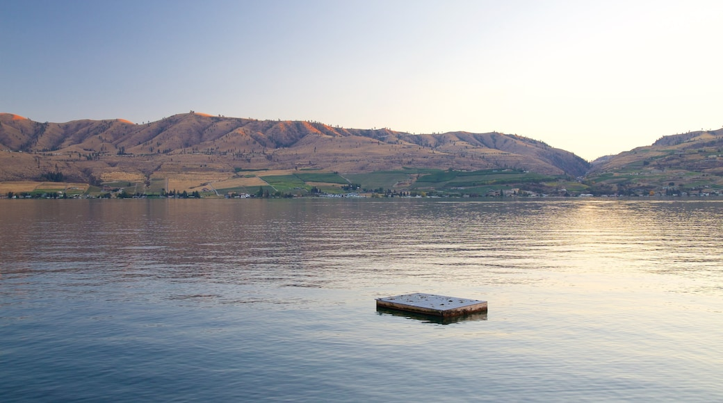 Lake Chelan featuring a lake or waterhole, a sunset and tranquil scenes