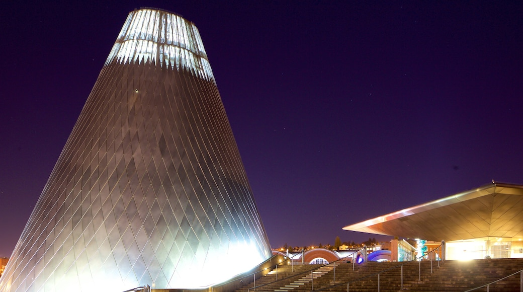 Museum of Glass which includes modern architecture and night scenes