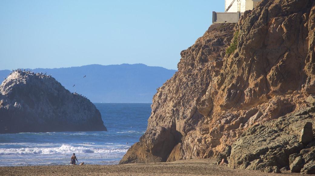 Ocean Beach showing landscape views, a sandy beach and rugged coastline