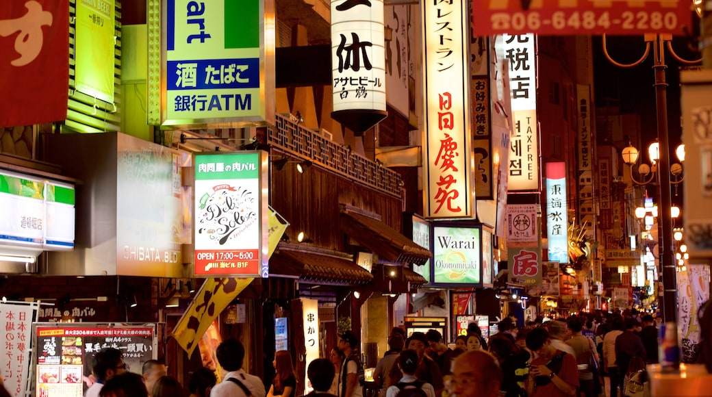 Dotonbori showing street scenes and signage