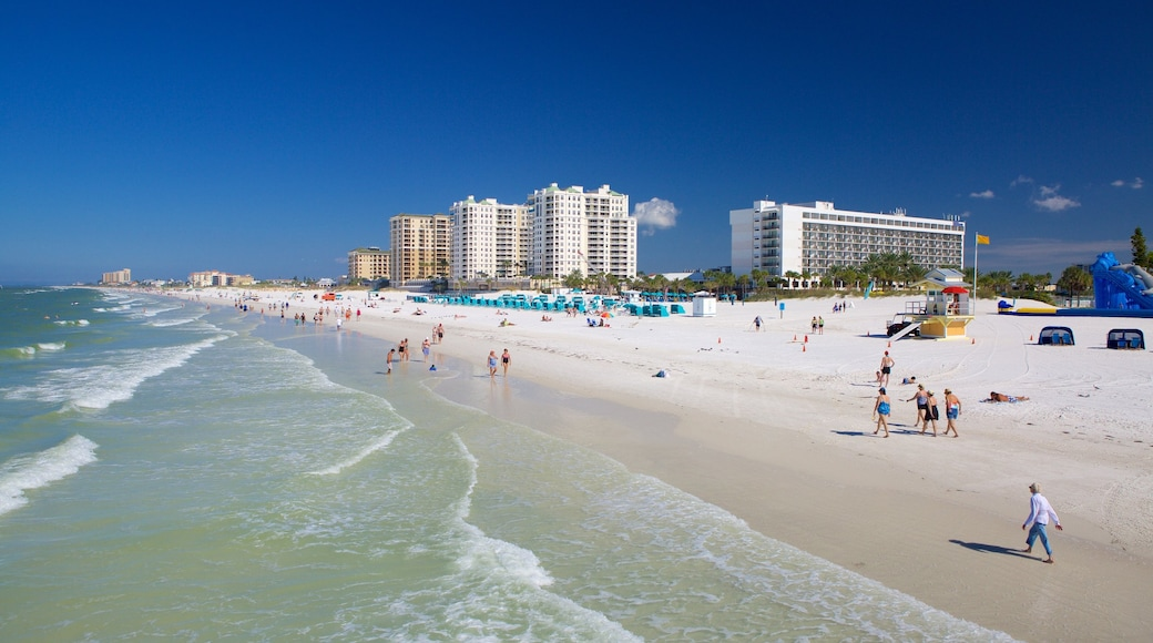Clearwater Beach which includes a coastal town and a beach