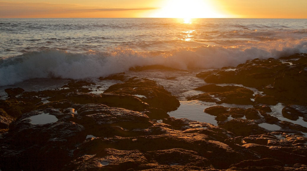 Kailua-Kona featuring a pebble beach, a sunset and general coastal views