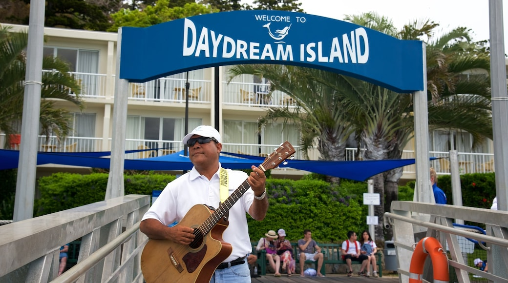 Daydream Island featuring signage as well as an individual male