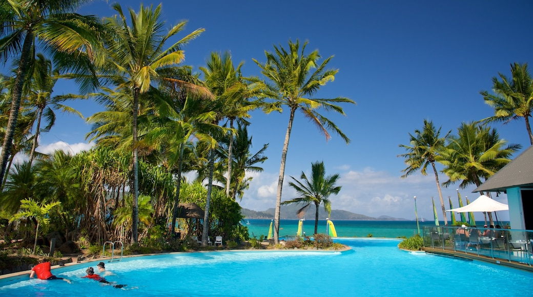 Catseye Beach showing a luxury hotel or resort, swimming and a pool
