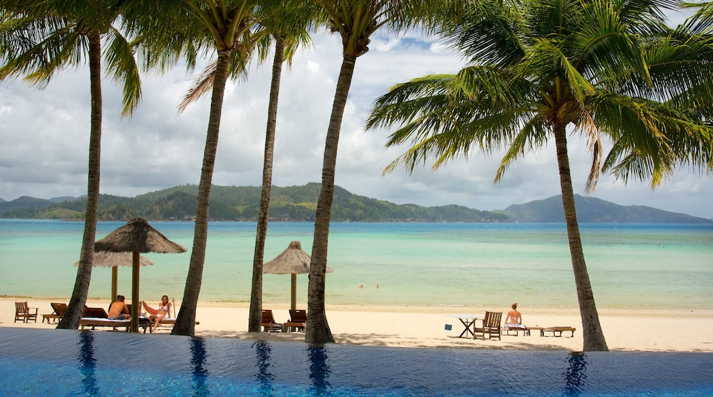 Hamilton Island featuring a luxury hotel or resort, a pool and a sandy beach