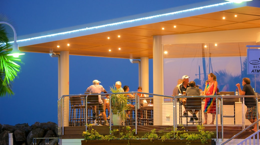 Abell Point Marina featuring dining out, a bar and night scenes