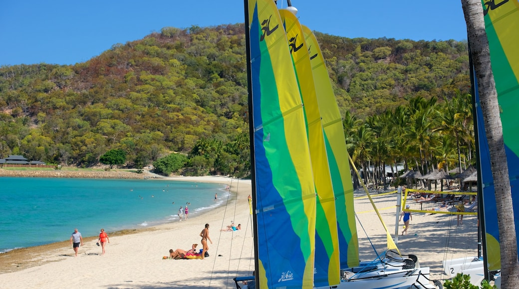 Catseye Beach which includes a beach and sailing as well as a small group of people
