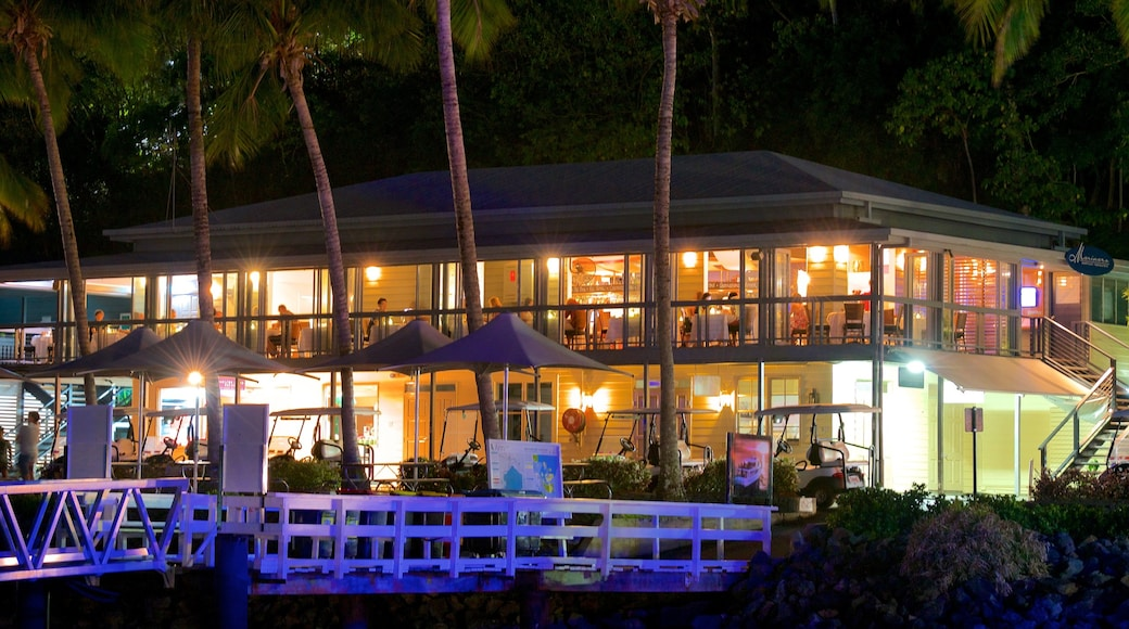Hamilton Island Marina which includes dining out, outdoor eating and night scenes