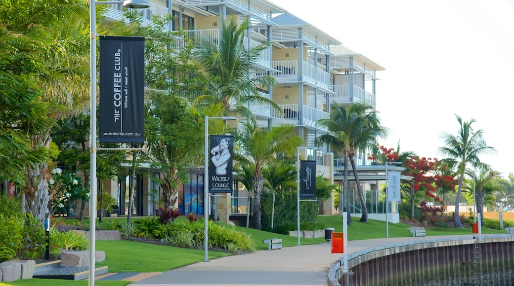 Airlie Beach which includes signage and a luxury hotel or resort