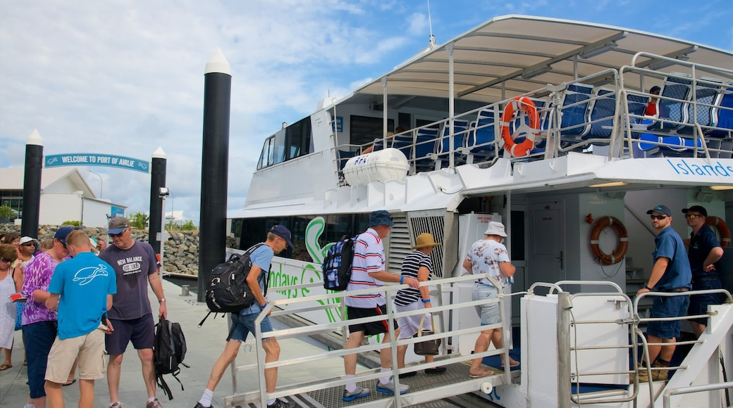Airlie Beach which includes cruising and a ferry as well as a small group of people