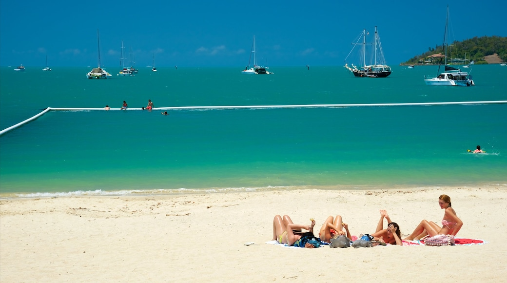 Airlie Beach which includes a beach and swimming as well as a small group of people