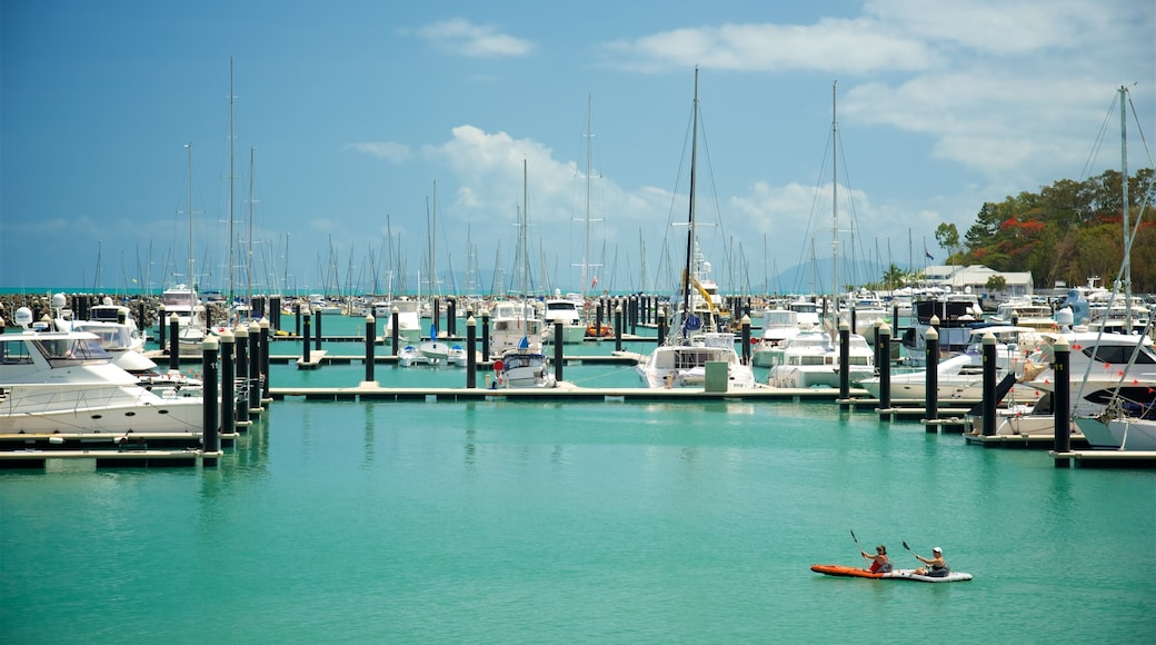 Airlie Beach showing kayaking or canoeing, a bay or harbour and sailing