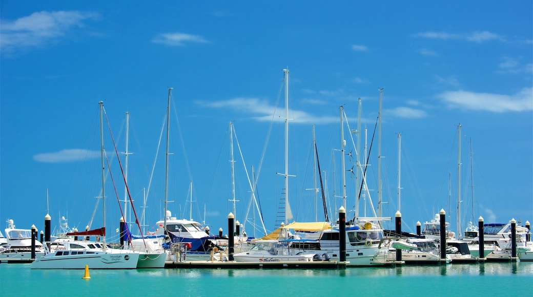 Airlie Beach which includes sailing, boating and a bay or harbour